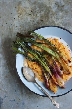 red curry roasted spring onions with creamy coconut polenta via With Food & Love