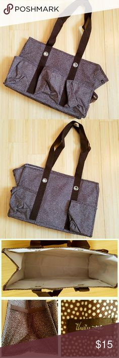 Brown & Cream Polka Dot Thirty-One Utility Tote Pockets, pockets, everywhere! Thirty-One utility tote in brown and cream polka dots. 7 exterior pockets. EUC. Received as a gift and rarely used. It's been living in a storage bin for awhile. Thirty-One Bags Totes