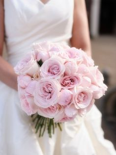 Close up of Hispanic bride holding bouquet of roses by Gable Denims on 500px