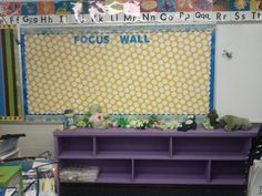 Plastic tablecloths from the dollar store make durable bulletin board coverings.