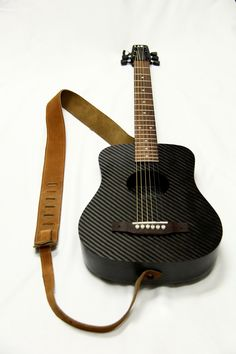 The KLOS carbon fiber travel guitar. It is durable and portable.