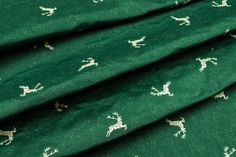 Dekostoff Two-sided jacquard - Small deer - fir
