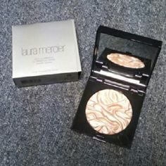 Laura Mercier Indiscretion Face Illuminator Brand new, never used. Limited edition. Beautiful soft rose gold highlighter! Willing to negotiate on price! Also if this is bought over this weekend, I will ship on Tuesday. Laura Mercier Makeup Luminizer