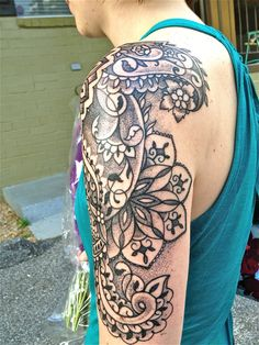 Indian-inspired dotwork floral tattoo by artist Dan DiMattia.