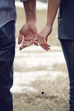 We HAVE to do this! This is how we hold hands at church and it'd mean so much to have that with our rings.