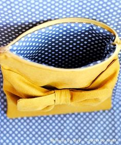 Adorable bow pouch tutorial from Mommy by Day, can think of so many uses for this!