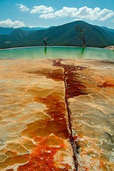 """Hierve el Agua Mineral Spring, Oaxaca, Mexico. Mineral deposits at the top of a stone """"waterfall."""""""