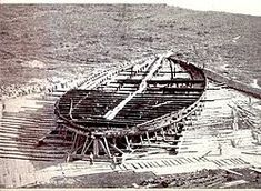 Nemi ships - Wikipedia, the free encyclopedia: The remains of the hull of one of the two ships recovered from Lake Nemi. Workers in the foreground give an indication of scale.