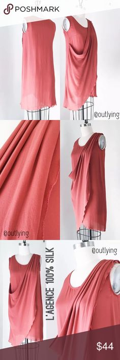 L'AGENCE Silk Tank Dress L'AGENCE Silk Wrap Drape Tank Dress Retail Price: $395 NWOT / Never Worn Sample Size: S Color: Coral Length 38, Bust 34, Hip 35  Light silk chiffon in an effortless draped design with soft pleats at the shoulder, subtle scoop neck, easy shift tank dress silhouette and a picot embroidered edge stitch.  L'AGENCE is created by legendary stylist agent Margaret Maldonado, L'AGENCE was launched in 2008. L'AGENCE Dresses
