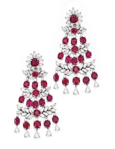 Jayne Wrightsman , Platinum, Ruby and Diamond Earclips $46,875.00 ,chandelier design, set with 30 round and cushion-cut rubies, accented by numerous round, pear and marquise-shaped diamonds set in foliate motifs weighing approximately 11.45 carats, gross weight approximately 25 dwts.