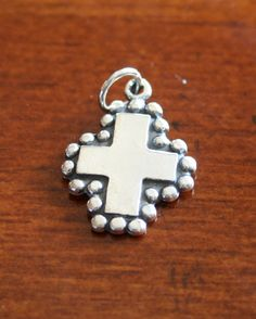 This sterling silver Cross Charm will make a great keepsake religious jewelry gift for someone wanting to express their Christian faith, a Confirmation gift, Baptism gift, First Communion Gift, Christening, Reconciliation gift, mom necklace, or wedding gift.