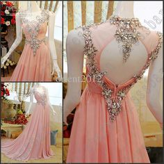 long, blush prom dress with embelishment and keyhole back
