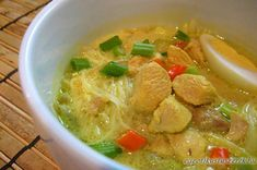 Indonesian Soto Ayam (Chicken Noodle Soup) recipe - To kick up the flavor of the traditional Soto Ayam, this variation is infused with coconut milk and more spices. Serve hot with lime wedges. Chicken Noodle Soup, Chicken Soup Recipes, Recipe Chicken, Soto Ayam Recipe, Easy Delicious Recipes, Yummy Food, Asian Kitchen, Asian Recipes, Ethnic Recipes