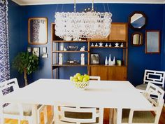 Totally love the dark walls and bright accents and furniture!