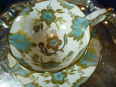 ROYAL STAFFORD TEA CUP AND SAUCER BLUE AND GOLD FLOWER AND LEAF DECORATION FAB.  #CUPANDSAUCER #ROYALSTAFFORD