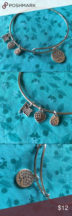 "Silver Charm Bracelet Cute silver charm bracelet - perfect for casual summer days! Has that slightly antiqued/rustic feel to it. Heart shaped flag charm says ""made in USA"" on back. 2 3/4 in diameter. Bundle and save even more! :) Jewelry Bracelets"