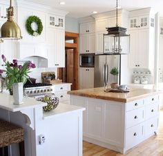 Cottage kitchen, marble and wood counter tops, lantern, ceiling height cabinets, subway tile...