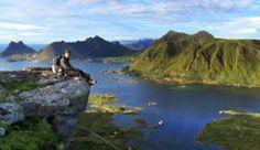 Jeremy Fischer sitting on the edge of a cliff near Stamsund in the Lofoten Islands, Norway. - Photo: Jeremy Fischer