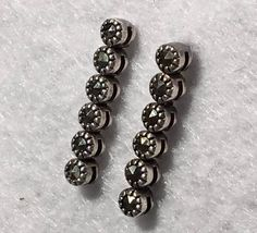 Lovely Articulated Sterling Silver and Marcasite by Statusjacker