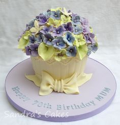 - Giant Cupcake decorated to look like a Hydrangea plant, with fondant bow for a friends Mum's 70th Birthday x