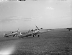 A section of Supermarine Spitfire Mark IAs of No. 616 Squadron RAF prepare for an evening take-off from Fowlmere, Cambridgeshire