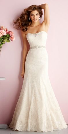 THIS IS IT! I found the dress I want to wear on my wedding day! I love that it doesn't look like a mermaid. I love the tight lace. The only thing I don't like the extra fabric on the neckline. It's supposed to be a sweetheart. Style:2703