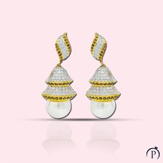A mid-sized earring has a mix of style, subtlety and conventional look all in one. Can be worn during a traditional setting or a night out. Made in silver with white and chocolate cubic zirconias and pearls. Silver Jewellery Indian, Gold Jewellery Design, Silver Jewelry, Fine Jewelry, Silver Bracelets, Silver Earrings, Stud Earrings, Indian Fashion Bloggers, White Chocolate