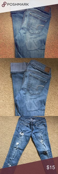AE size 2R distressed SKINNY jeans Excellent condition distressed size 2R AE SKINNY jeans. So versatile! Wear them cropped for capris of tucked into boots during the winter. All distress, rips and tears are part of the design! NO stains! American Eagle Outfitters Jeans Skinny
