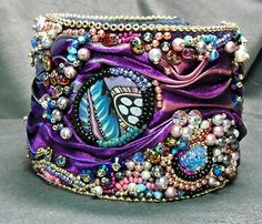 "This bead embroidery bracelet I call ""Gypsy's Silk"".  The ""Gypsy"" part is probably kind of obvious, and the ""Silk"" comes from the Shibori silk I used in it.  Enjoy!!! Ribbon Jewelry, Soutache Jewelry, Beaded Jewelry, Gypsy Jewelry, Embroidery Jewelry, Beaded Embroidery, Shibori, Bead Art, Bead Weaving"