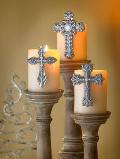 Candlesticks w/ crosses  I makes these by hot gluing tacks to crosses and then gently inserting hot tacks into candle - holding until cooled!!!! - Karen Chapman