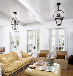 Bright and airy.  Love the Quoizel lighting (#RO1914AC Rue de Royal Hanging Lantern from the Charleston Collection)