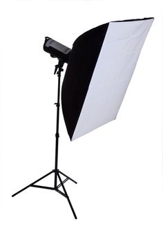 A softbox diffuses the light into a pleasing soft, even light. When used properly, it reduces harsh shadows. The closer the softbox is to the model or subject, the softer the light appears, emulating window light. The shape of a softbox can vary from rectangular to octagonal to square to a long strip of light.