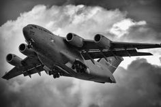 A Boeing C-17 Globemaster III on final approach, during a thunderstorm, to Wright-Patterson Air Force Base. The rain is clearly visible as the plane cuts through the downpour.