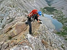 Learn Basic Rock Scrambling Techniques for Climbing Mountains: Susan Joy Paul scrambles along the airy Southwest Ridge of 14,042-foot Ellingwood Point in Colorado.
