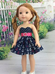 14.5 inch doll dress made to fit Wellie Wishers size dolls. This dress has a sweetheart bodice of white dots on Navy, which coordinates well with the White and Pink Anchor design in the Navy skirt fabric. Also included is a Hot Pink ribbon belt/sash with a Silver buckle center. Sash will tie in back in a cute bow. Wear without the belt for a more casual look. Dress bodice is fully lined and closes in back with hand sewn snaps. My doll and her shoes are not included. Please ask any que...