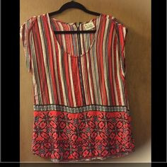 Cute blouse Cute Aztec top. It was o e of my favorites it just doesn't fit anymore Tops Blouses