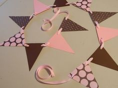 Paper Garland Pink and Brown Baby Shower Decorations Paper Bunting Photo Prop Girl Birthday Decor Party Decor. $9.75, via Etsy.