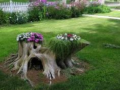 Looks like a Fairy House! Great way to deal with an interesting old stump!
