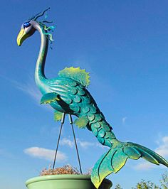 Mermaid (or Sea Dragon) - handmade, garden art sculpture created from a recycled pink plastic flamingo.. $70.00, via Etsy.
