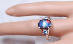 Ammolite Jewelry From Canada - Ammolite ring.Rare Blues and Red/Pink.Natural Tanzanites., USD259.00 (http://www.ammolitejewelryfromcanada.com/ammolite-ring-rare-blues-and-red-pink-natural-tanzanites/)