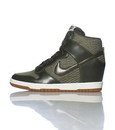 NIKE High top women s wedge sneaker Lace up closure Mesh for breathability  Padded tongue with NIKE logo Cushioned inner sole Greyish khaki color ad0075eb3