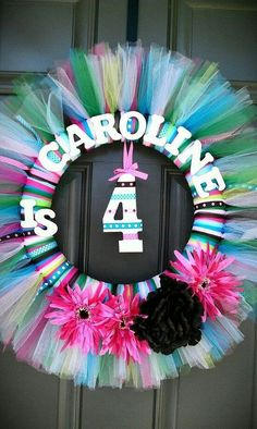 Birthday wreath made from ribbons and tule around a foam wreath circle. Works for any occasion, not just birthdays
