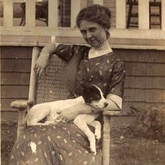 A lovely old photo of a woman & her dog.  You can see their bond.