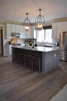 There's always time to stop and enjoy your breathtaking hardwood flooring. Get the look at RiteRug Flooring! | Kitchen Decor Ideas | Hardwood Floor | Rustic Decor