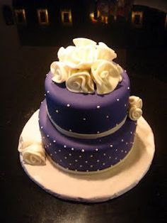 It is rare that I find a purple cake I like but I love the purple base with white roses.  Beautiful!