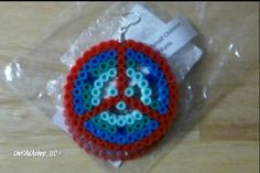 """One of a kind earring. Made of perler bead material w/hypoallergenic ear hoop. Approx 2"""" in diameter - .004oz. in weight. 