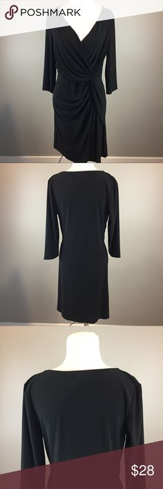 """White House Black Market Stretchy Black Dress White House Black Market woman's black Stretchy 3/4 Sleeved side Twist dress. Has a v Neck wrap style neckline. Good pre owned condition. Comes from a smoke free home.  Size Med Measurements: Armpit to armpit laying flat 17"""" Length from top of shoulder to bottom of dress 38"""" Material: 95%polyester 5%spandex White House Black Market Dresses"""