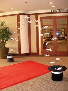 Magic Theme : birds hung with fishing line from ceiling