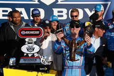 Kevin Harvick Photos Photos - Kevin Harvick, driver of the #4 ditech Chevrolet, celebrates in Victory Lane after winning the NASCAR Sprint Cup Series Bad Boy Off Road 300 at New Hampshire Motor Speedway on September 25, 2016 in Loudon, New Hampshire. - NASCAR Sprint Cup Series Bad Boy Off Road 300