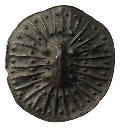 Africa | Ethiopian Shield | Most Ethiopian shields are made from a very thick, tough leather, said to be hippopotamus hide. They are stretched and hammered over (often elaborate) wood forms, dried and removed